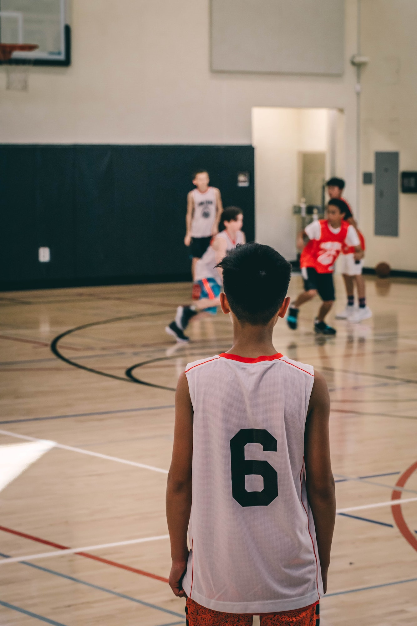 sports and camp physical - teen boys on basketball court
